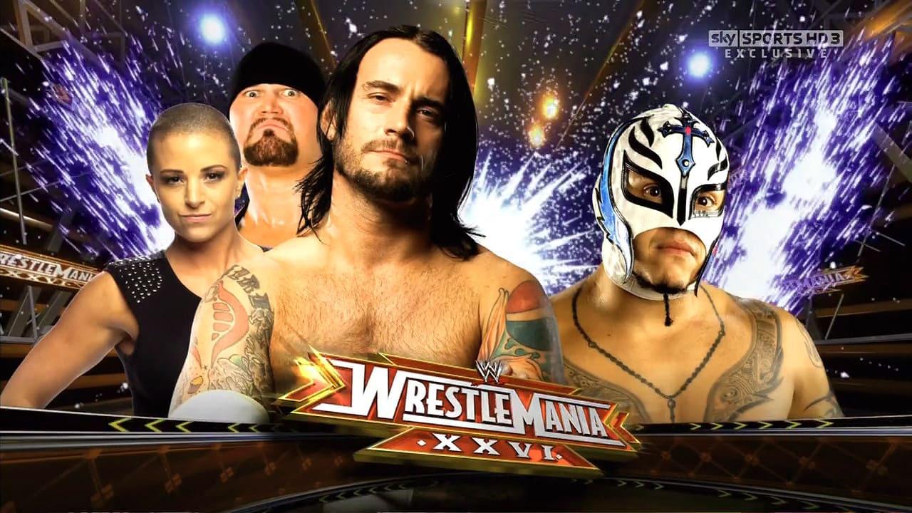 Rey Mysterio vs. CM Punk y SES en WM XXVI