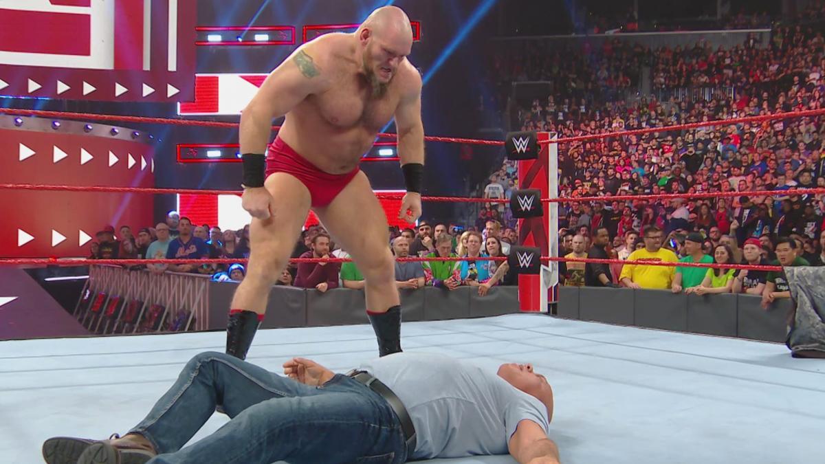 Lars Sullivan and a sore Kurt Angle at his feet / WWE